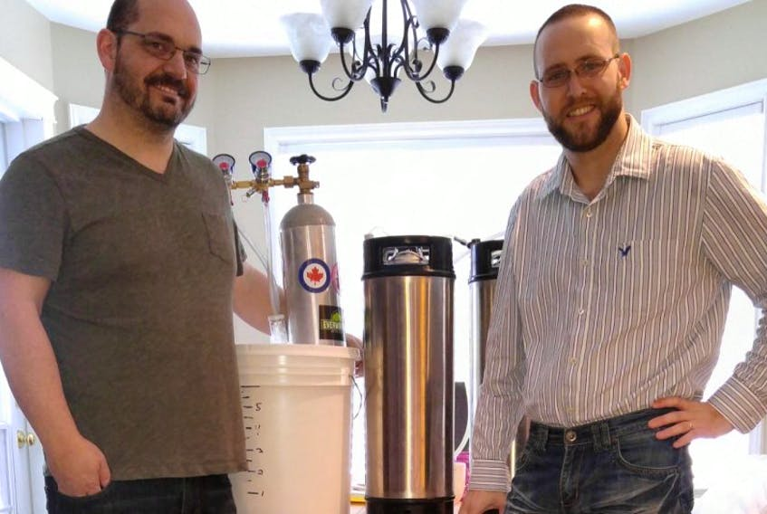 Dave Jerrett, left, and Sam Newman ready a batch of their latest craft beer. Their aim is to open Scudrunner Brewing Limited in Gander.