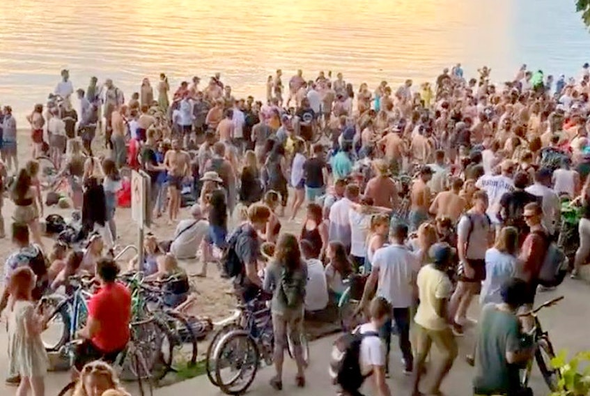 Scores of people held a party on Third Beach in Vancouver Tuesday night despite pleas from health officials to maintain social distancing protocols as the number of COVID-19 cases spike in B.C.