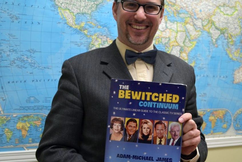 Stratford resident Adam Michael James holds a copy of The Bewitched Continuum: The Ultimate Linear Guide to the Classic TV Series. The superfan wrote the book in six months in honour of the show's 50th anniversary.