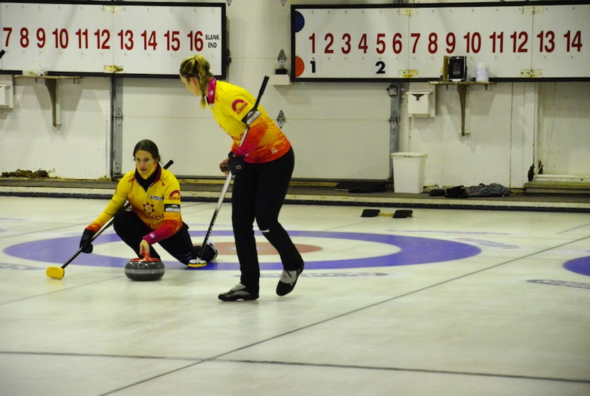 Skip Suzanne Birt makes a shot as second Meaghan Hughes prepares to sweep during the P.E.I. women's curling championship in O'Leary in January. The Birt rink is 3-2 (won-lost) at the 2021 Scotties Tournament of Hearts Canadian women's curling championship in Calgary.