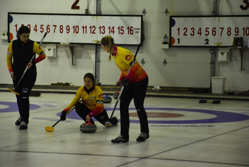 Skip Suzanne Birt releases a shot while lead Michelle McQuaid, left, and second Meaghan Hughes are ready to sweep during the P.E.I. women's curling championship in O'Leary recently. The Birt rink is representing P.E.I. at the 2021 Scotties Tournament of Hearts Canadian women's curling championship in Calgary this week.