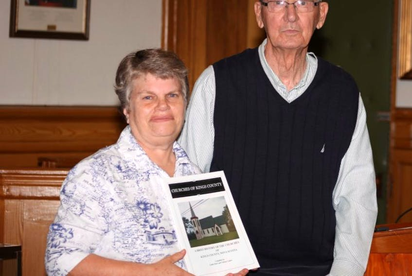 Co-authors Linda Hart, left, and Nelson Labor with their new book, 'Churches of Kings County', which was launched Sept. 18 at the Kings County Museum. Copies of the book are available for $25 at the museum.