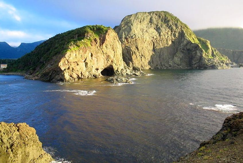 """<div class=""""description mw-content-ltr en"""" lang=""""en"""" dir=""""ltr"""">Looking across the Bottle Cove's mouth at the cave. To the left is one of the sandiest beaches in Newfoundland and Labrador.&nbsp;<span>Eugene Cormier/Wikimedia Commons</span></div>"""