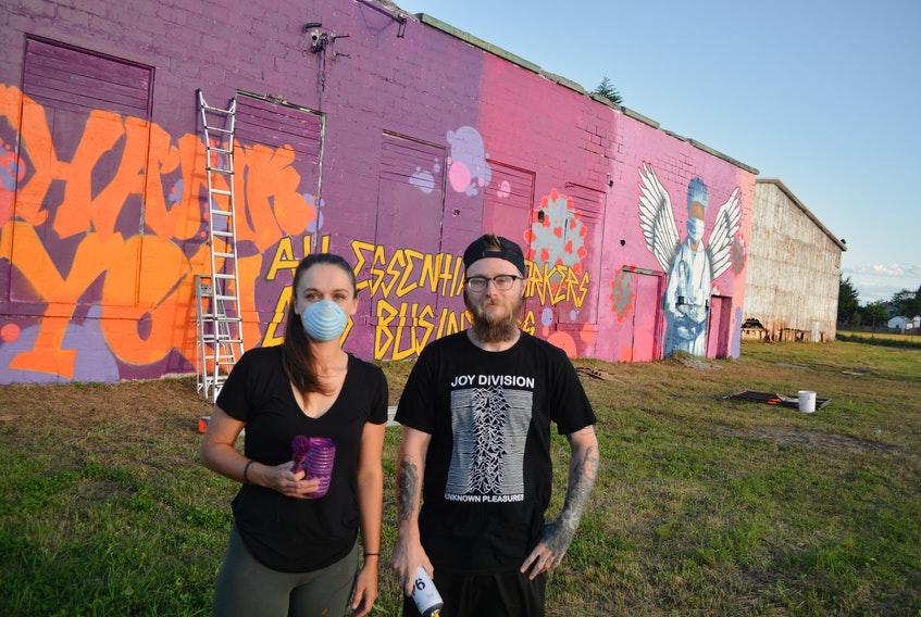 Artists Melissa Francis (left) and Marshall Borland recently finished a mural in Botwood thanking essential workers for their work during the COVID-19 pandemic. Nicholas Mercer/SaltWire Network