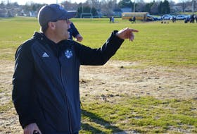James Voye, head coach of the Three Oaks senior AAA boys' rugby team, provides instructions to his players during a recent P.E.I. School Athletic Association Senior AAA Boys Rugby League game against the Westisle Wolverines in Summerside.