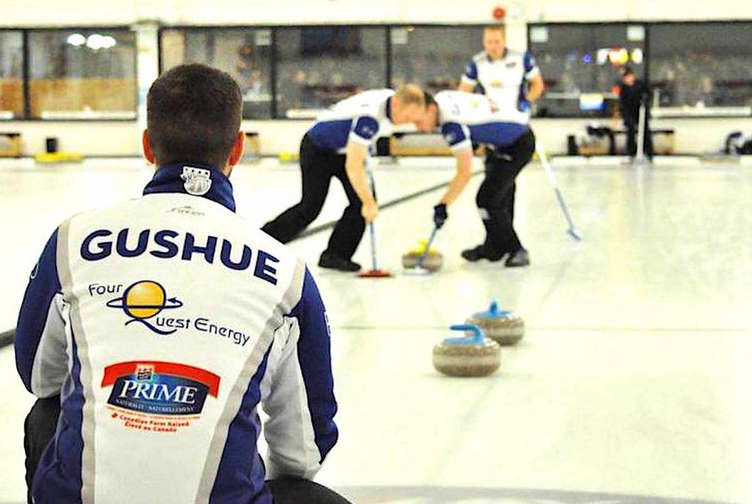 In this file photo, Brad Gushue watches as Mark Nichols and Brett Gallant sweep a shot by lead Geoff Walker during play in the 2016 Tankard provincial men's curling championship at the Re/Max Centre in St. John's. After two years away from Tankard competition as Team Canada, Gushue and his teammates return to play for the title in the 2020 Newfoundland and Labrador men's championship, beginning today at the Re/Max Centre. — Telegram file photo/Keith Gosse