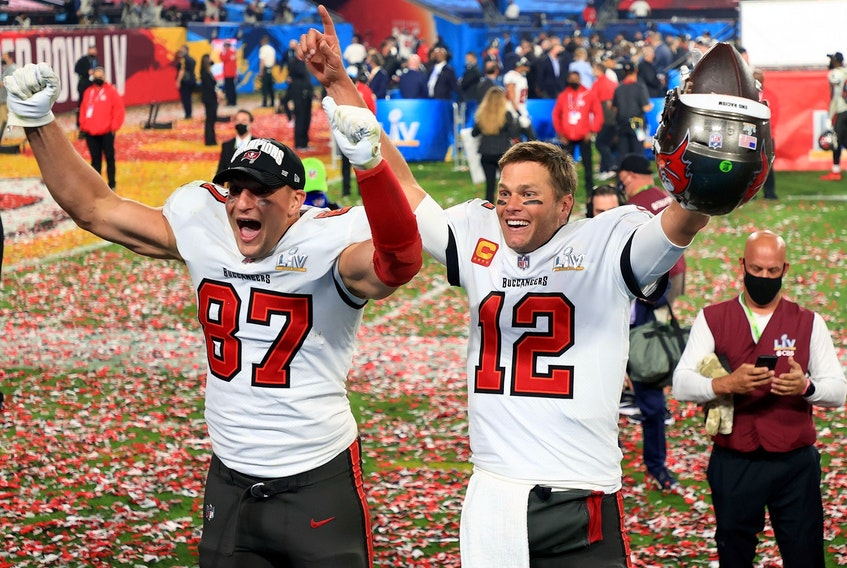Rob Gronkowski, left, and Tom Brady of the Tampa Bay Buccaneers celebrate after defeating the Kansas City Chiefs in Super Bowl LV at Raymond James Stadium on Feb. 7, 2021 in Tampa, Fla.