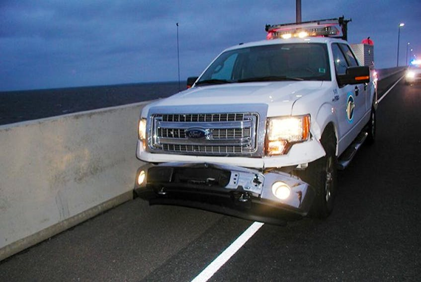 A Confederation Bridge utility truck damaged by and also similar to a utility truck that was driven by a man considering suicide Tuesday. The man had been briefly left alone in one of the utility trucks while the driver left to talk with police. The man then took off, dragging an approaching police officer a considerable distance in the process.