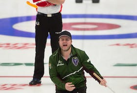 Tyler Smith of Team P.E.I. yells instructions to his sweepers during Wednesday's round-robing game against Team Canada's Brad Gushue rink at the 2021 Tim Hortons Brier in Calgary. Smith moved up from the third position to skip the game. Team Canada won the game 8-4.