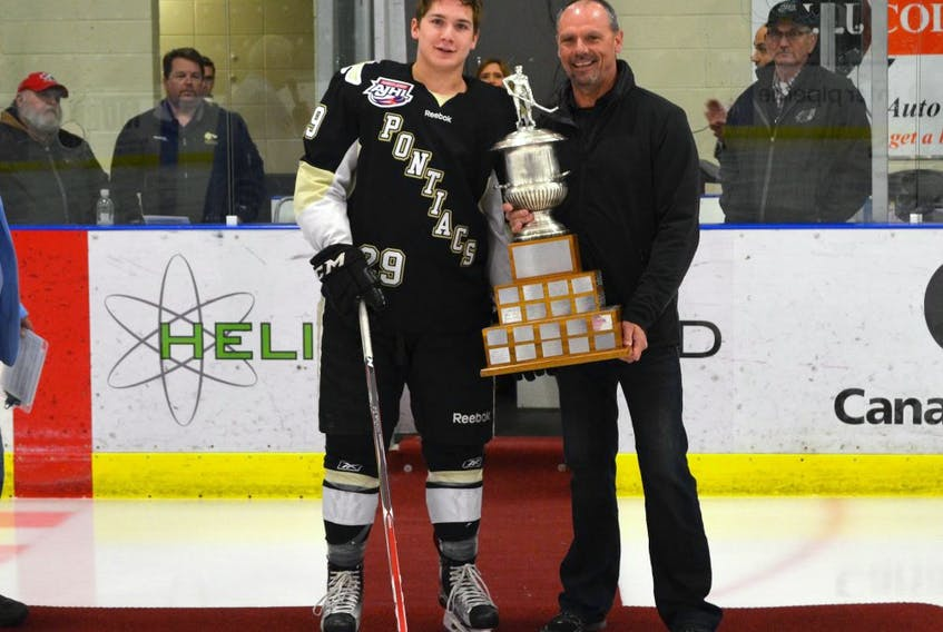 Brinson Pasichnuk of the Bonnyville Pntiacs is presented the award for the top defenceman by AJHL commissioner Ryan Bartoshyk on Sunday February 28, 2016 in Cold Lake, Alta.