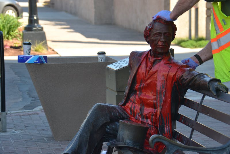 City workers clean off red paint dumped on the John A. Macdonald statue on June 19, 2020.  - Stu Neatby