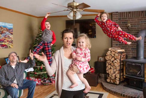 Dave and Erin Brosha had a little photo fun with their family Christmas picture, which includes their children Luke, 7, left, Liam, 5, and Lily, 2.
