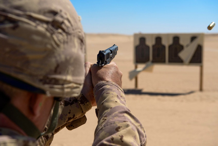 A Canadian Forces member practices firing the Browning 9mm pistol. (Canadian Forces photo)