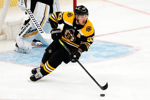 Boston Bruins forward Brad Marchand (63) skates with the puck during a game earlier this month against the New Jersey Devils. The Hammonds Plains star has been placed on the NHL's COVID-19 protocol list. - Winslow Townson / USA Today Sports