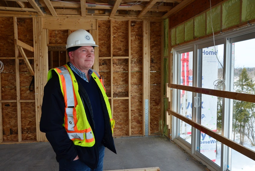 Parsons Green Developments president Noel Taiani looks out over the Cornwallis River valley from the fifth floor of a building currently under construction as part of the Miners Landing development. KIRK STARRATT