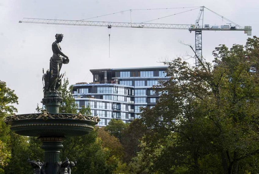 The John W. Lindsay YMCA, under construction, is seen behind the Victoria Jubilee Fountain in the Halifax Public Gardens, in September. New construction across the province is driving an increase in the property assessment roll.