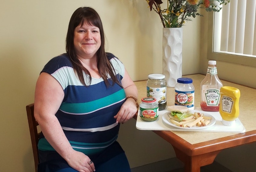 As long as it's got the condiments, Aimee Pennell can do without a patty on her burger. Pennell is one of three influencers helping spread the word about the 12 Months 12 Miracles Best in the West Burger Competition for the Corner Brook Firefighter's Toy Drive.