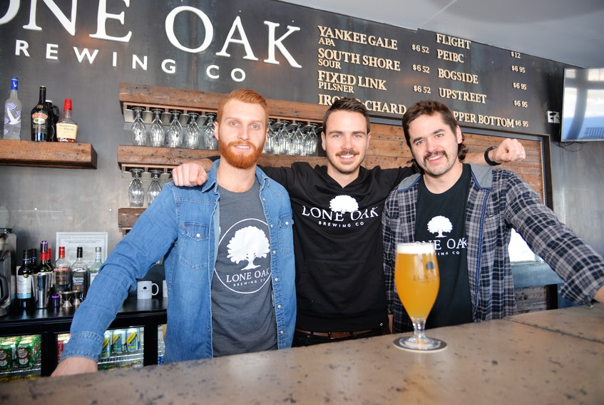 Dillon Wight, left, Jared Murphy and Spencer Gallant, the owners of Lone Oak Brewing Co. in Borden-Carleton, P.E.I., have taken to home deliveries as an additional way to generate revenue during COVID-19.