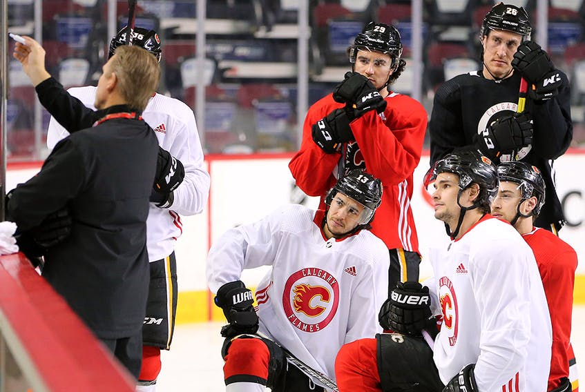 Calgary Flames players listen to drill instructions from head coach Geoff Ward during team practice in Calgary on Monday, February 3, 2020. Gavin Young/Postmedia