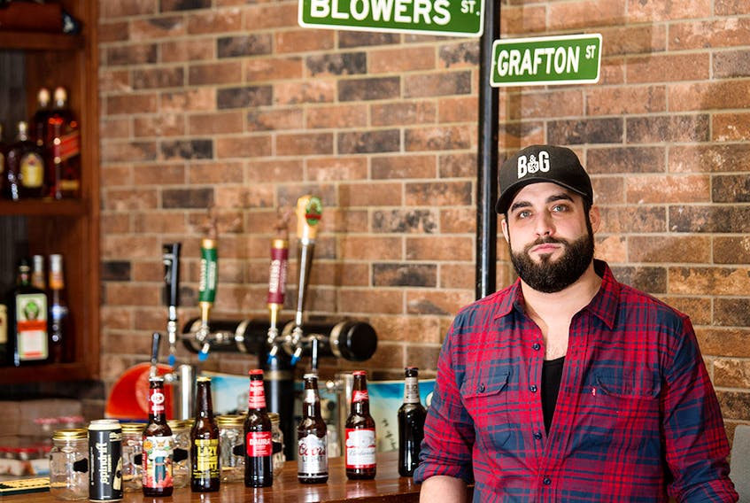 Josh Robinson, founder and owner with Blowers & Grafton, was photographed in his Calgary restaurant on April 21, 2020. The Halifax street food inspired eatery is donating all of their proceeds from orders on Tuesday to support those affected by the shooting in Nova Scotia.