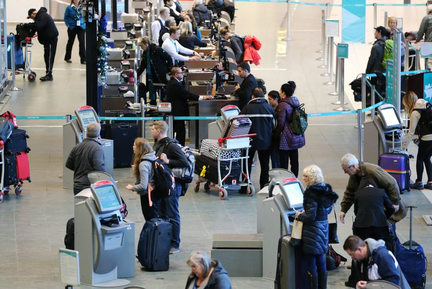Travellers move through the Calgary International Airport on Dec. 16, 2019.