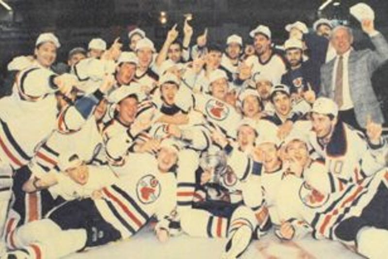 ['The Cape Breton Oilers are shown in the informal team photo that hockey teams often pose for after winning a championship.']