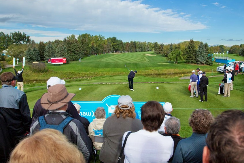 Fans watch as players tee off on the first hole in Round 1 of the Shaw Charity Classic at the Canyon Meadows Golf Club in Calgary on Friday September 2, 2016. Gavin Young/Postmedia