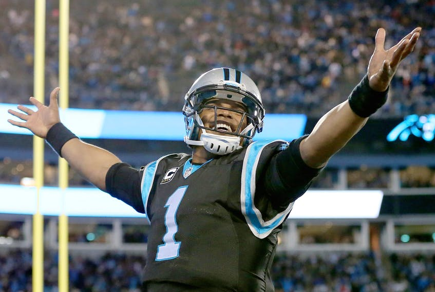 Cam Newton of the Carolina Panthers reacts after a touchdown against the Tampa Bay Buccaneers during their game at Bank of America Stadium on January 3, 2016 in Charlotte. (Streeter Lecka/Getty Images)