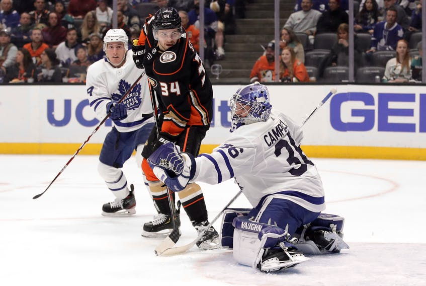 Maple Leafs goaltender Jack Campbell stops the Ducks' Sam Steel on Friday night in, Anaheim, Calif. Campbell continues to provide solid back-up goaltending for Toronto. (Marcio Jose Sanchez/The Associated Press)