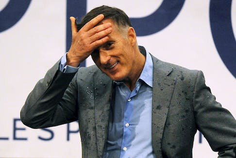 Leader of the People's Party of Canada Maxime Bernier stands with a soaked shirt after an audience member threw a glass of water at him after his speech to supporters in Fredericton on Sept. 17, 2019.