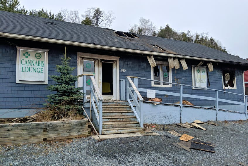 """A building extensively damaged by fire on the Bedford Highway overnight Thursday was formerly a vaping supply store and now has """"cannabis lounge"""" signs in the window. - The Chronicle Herald"""