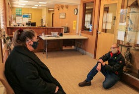 Sheila Christie and Scott Sharplin participate in a provincewide sit-in in solidarity with Jacob Fillmore's hunger strike, at the Department of Lands and Forestry office in Coxheath, Nova Scotia, on Tuesday. JESSICA SMITH/CAPE BRETON POST