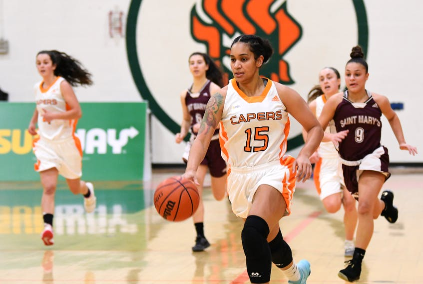 Audrey Rankin of the Cape Breton Capers women's basketball team carries the ball during Atlantic University Sport action at Sullivan Field House last season. The 25-year-old played her final game as a Caper in the squad's 64-59 loss in the AUS quarter-finals over the weekend. CONTRIBUTED/VAUGHAN MERCHANT, CBU ATHLETICS
