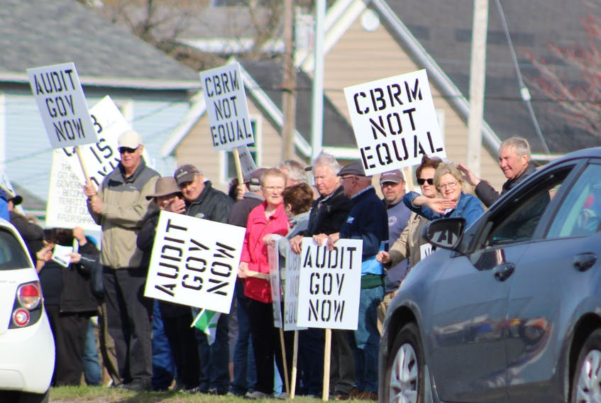 These protesters, shown here waving at vehicles on Prince Street, were among an estimated 600 people who turned out for June 2018 rally in front of Sydney's provincial building. The rally, organized by Nova Scotians for Equalization Fairness, was held to send a message to the provincial government that Cape Breton wants its fair share of the federal equalization transfer payment that Nova Scotia receives each year. DAVID JALA/CAPE BRETON POST