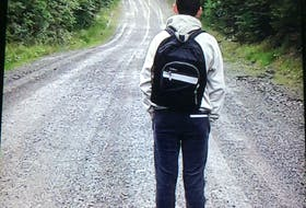 Aidan Matheson, 13, looks down the gravel road he lives on, which he walks to get to the bus stop. His family is concerned the 2.4 km walk, often in the dark during late fall and winter, isn't safe. CONTRIBUTED