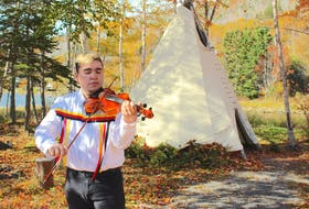 Morgan Toney, a Mi'kmaq fiddling sensation originally from We'koma'q and Wagmatcook First Nations, plays at Goat Island in Eskasoni before shooting a music video for his new song. Chris Connors/Cape Breton Post