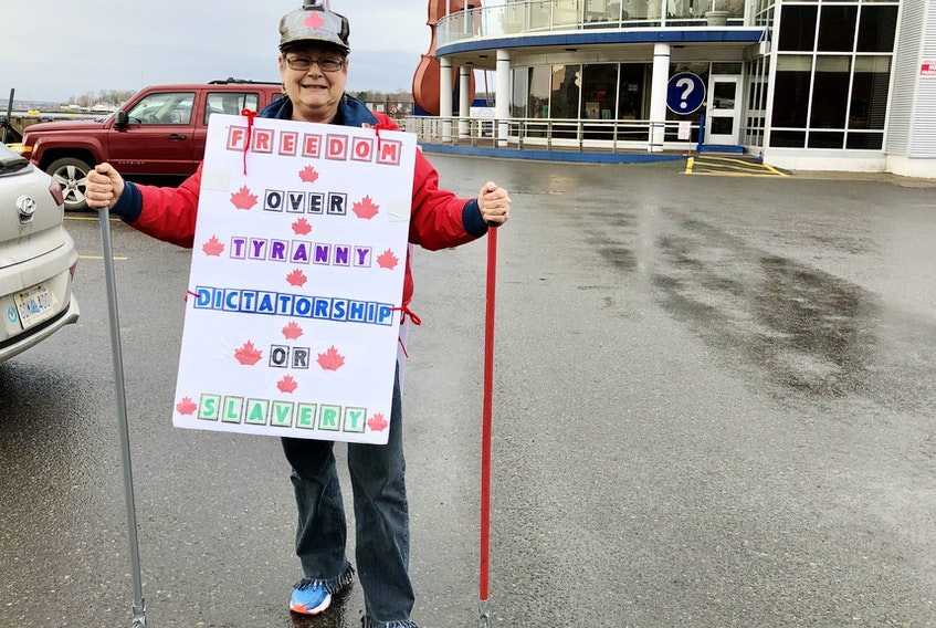Darlene LeBlanc wore signs she's been making since the summer, hoping there would be a protest against mandated COVID public health directives in Cape Breton. NICOLE SULLIVAN/CAPE BRETON POST