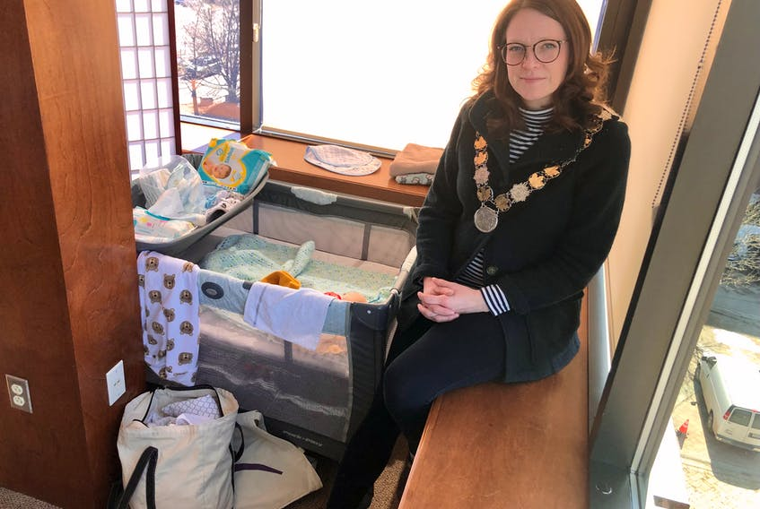 CBRM Mayor Amanda McDougall sits in her office on Monday next to a playpen in the back corner for her three-month old son, Emmett, when she takes him to work with her. NICOLE SULLIVAN/CAPE BRETON POST