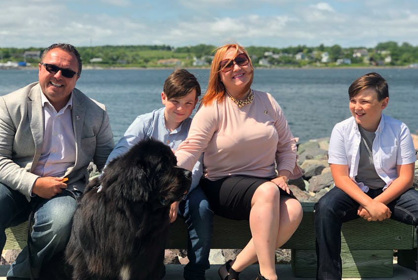 Realtors Terry Campbell, left, and Alexis Rudderham from Remax Nova The Cabot Group, with their sons William and Aubrey at the boardwalk in Sydney. CONTRIBUTED