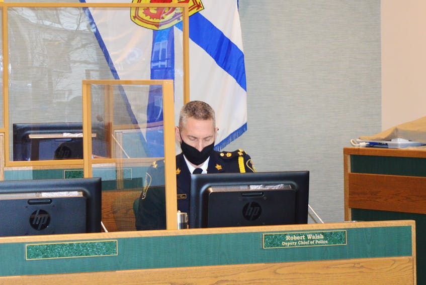 Cape Breton Regional Police acting Police Chief Robert Walsh prepares to go through the police department's budget on Monday at city hall council chambers. IAN NATHANSON/CAPE BRETON POST