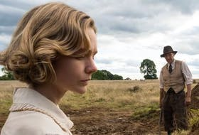 Carey Mulligan and Ralph Fiennes star in the movie The Dig. - Netflix