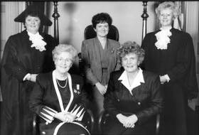 ['This photo, shot in 1993, captured a unique moment in Prince Edward Island's political history. At the time, and for the first and last time in the province's history, the top five jobs in provincial politics were held by women. In the photo are Nancy Guptill (left), who was Speaker of the House at the time, Marion Reid, who was lieutenant governor, Pat Mella, who was leader of the Opposition, premier of the day Catherine Callbeck and Elizabeth Hubley, who was deputy Speaker.']