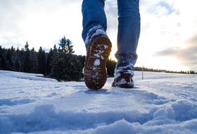 Walking in the snow can be one of the activities to help deal with the winter months. CONTRIBUTED