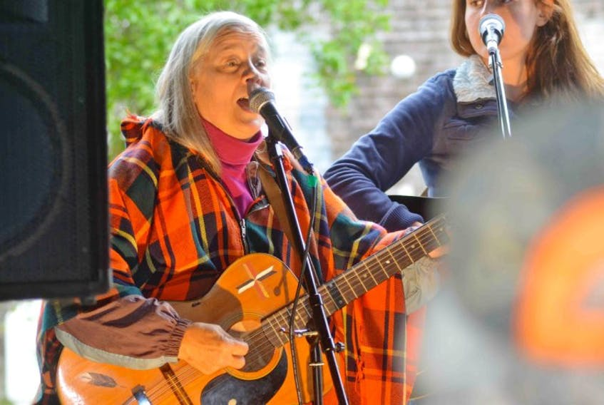 <p>Shelburne County resident Cathy Cook, who organized the event, shares a song with the group.</p> <p>Greg Bennett photo</p>