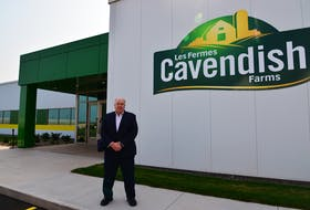 Cavendish Farms president Robert K. Irving stands in front of the new $12.5-million research centre unveiled on Thursday.
