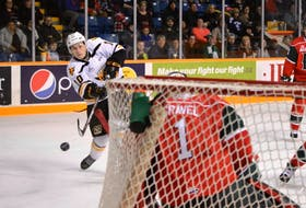 Ross MacDougall of the Cape Breton Screaming Eagles fires a shot on Alexis Gravel of the Halifax Mooseheads during first period Quebec Major Junior Hockey League action at Centre 200 on Friday. Cape Breton won the game 4-1.