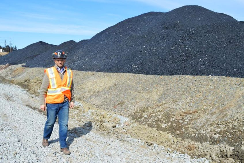 Shannon Campbell, manager at the Donkin Mine, walks by a coal pile in this Cape Breton Post file photo.