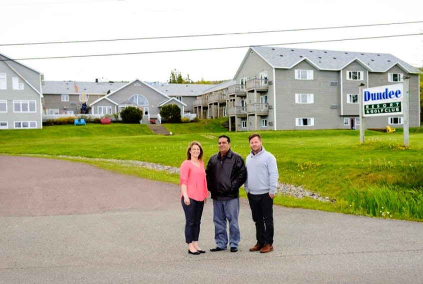 Judy McNamara, Dundee resort's operations manager, from left, new resort owner Sunny Grewal and Ryan Higgins, golf pro and director of golf at the Dundee Golf Club, are pictured in front of the resort. It was announced Monday that longtime owner Scott MacAulay of Cape Breton Resorts had sold the Dundee property to Grewal.