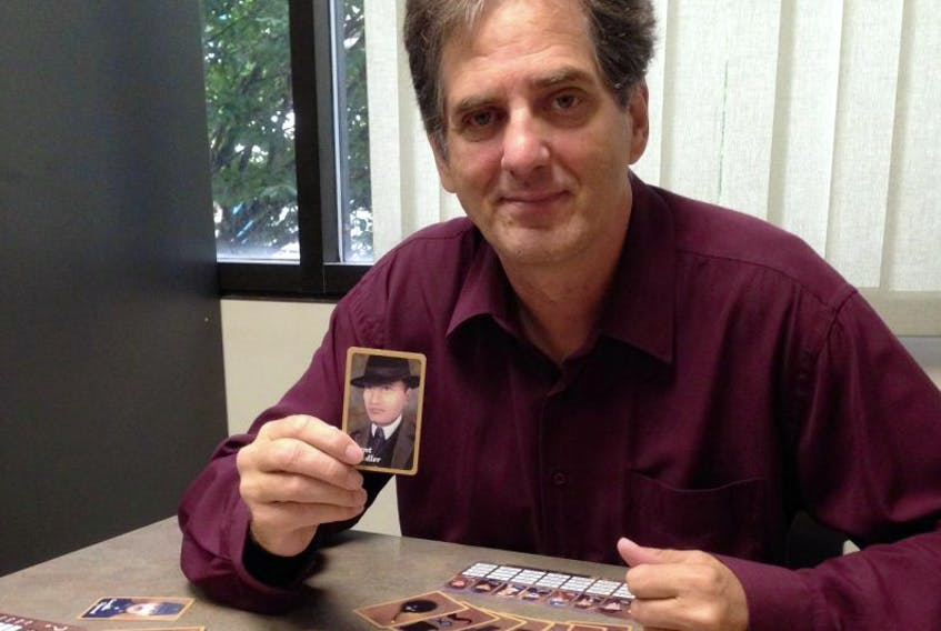 Randy Thompson, a native of New Waterford who now lives in British Columbia, shows playing pieces of his new card deduction game Get Adler! Thompson will unveil the new game in New Waterford on Oct. 28.