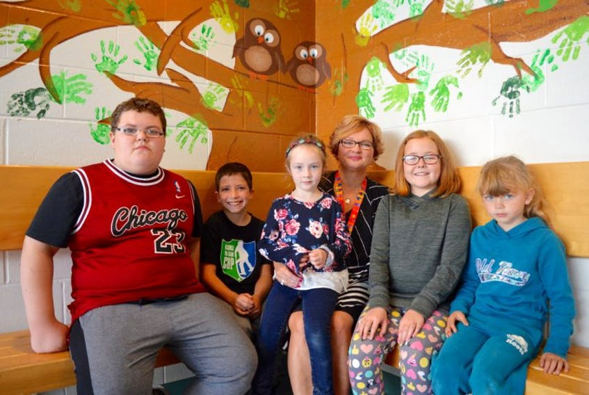 From left, Owen Burke, Owen Giorno, Avory Halliday, principal Sheila Kublek, Mary Claire Marsh and Tessa Young sit at Bras d'Or Elementary School on Wednesday. Bras d'Or Elementary School will be hold a Walk for Care event Friday.